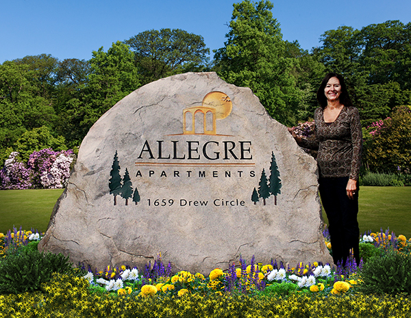 Engraved rock sign for Allegre Apartments