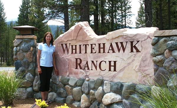 Sandstone entry monument sign for Whitehawk Ranch
