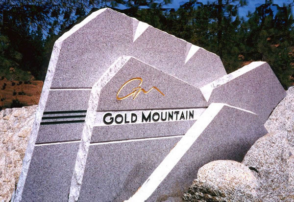 Polished stone entry monument sign for Gold Mountain, CA