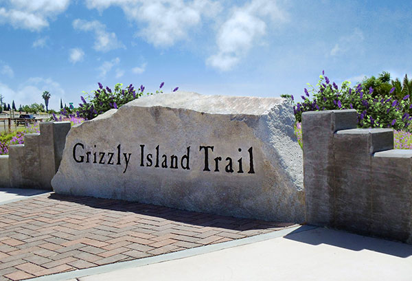 Granite entry sign for Gizzly Island Trail