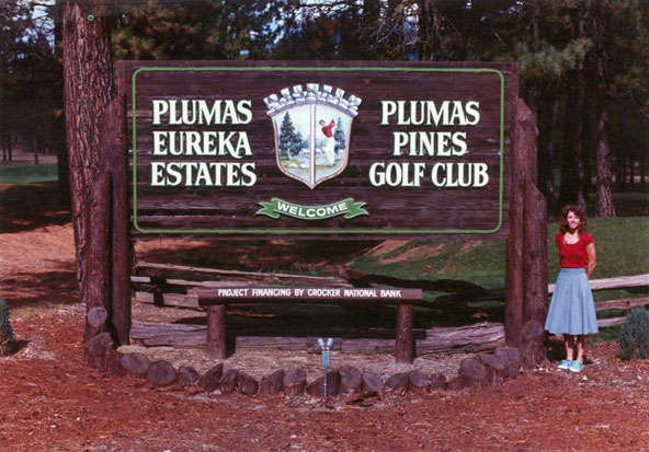 Wood entry sign for Plumas Pines Golf Club