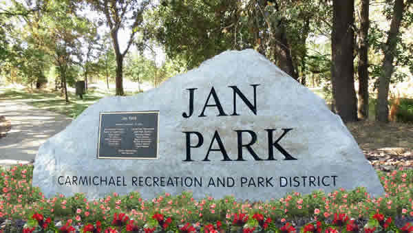 Stone and bronze park sign for Jan Park