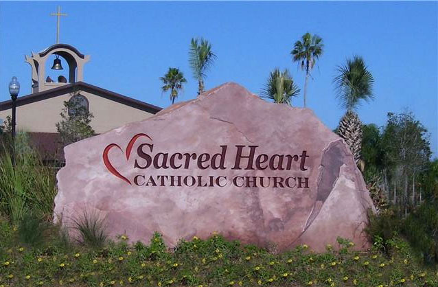 Natural sandstone sign for Sacred Heart Catholic Church