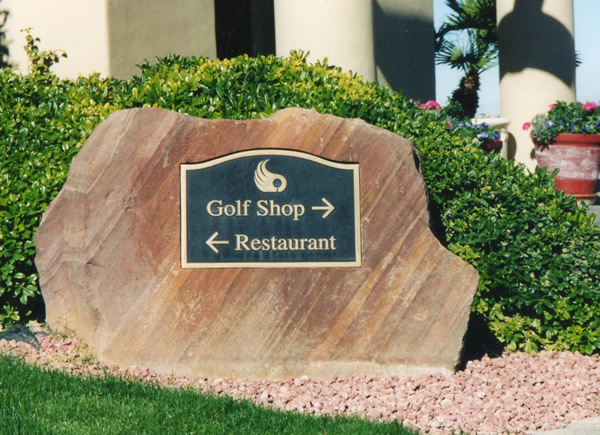 Sandstone and bronze directional sign for golf course